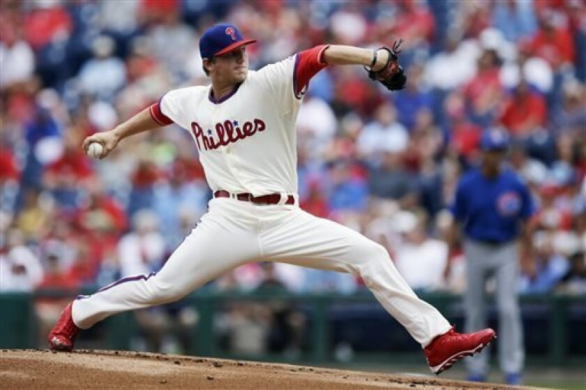 Philadelphia Phillies' Ethan Martin pitches in the first inning of a baseball game against the Chicago Cubs, Thursday, Aug. 8, 2013, in Philadelphia. (AP Photo/Matt Slocum)