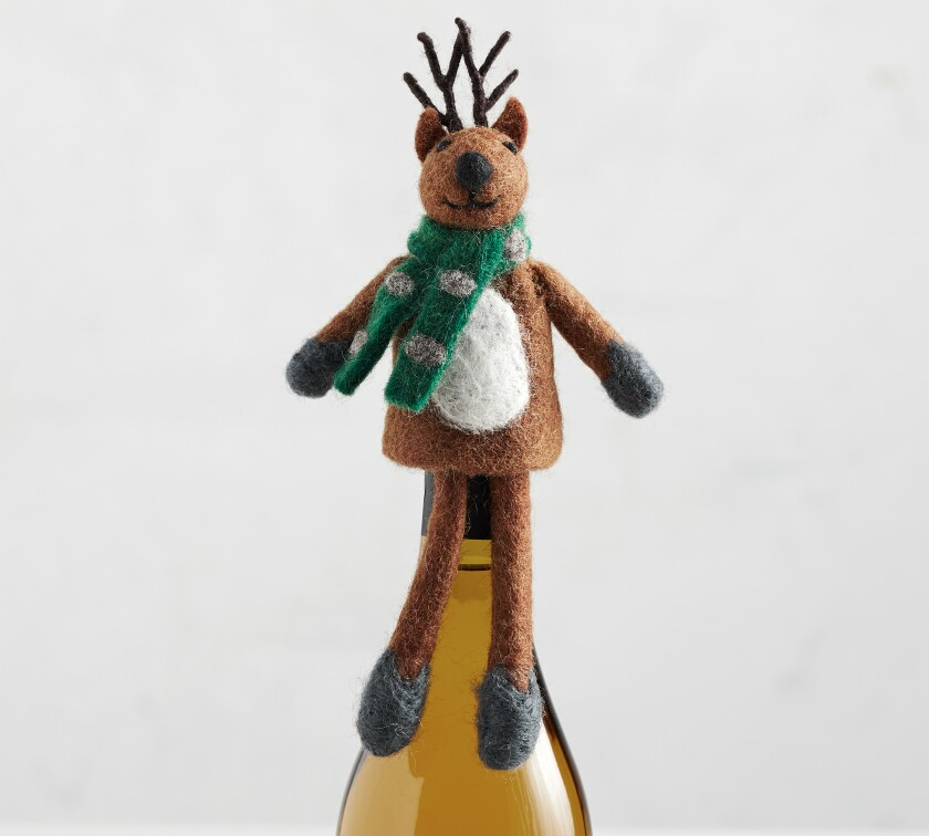 Reindeer Felt Wine Topper from Pottery Barn.