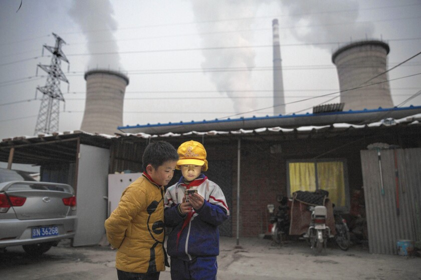 Advocates of carbon pricing argue that over the longer term, it would make coal-fired power plants, such as this one on the outskirts of Beijing, less competitive relative to wind turbines or carbon-free sources of electricity.