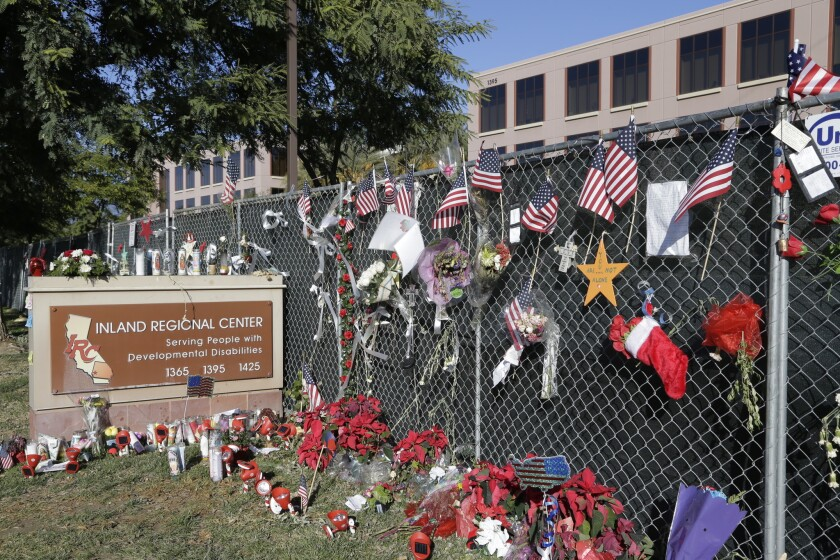 Flowers and American flags honoring the victims of the San Bernardino attack a few days later are placed outside the Inland Regional Center where the fatal shooting took place.