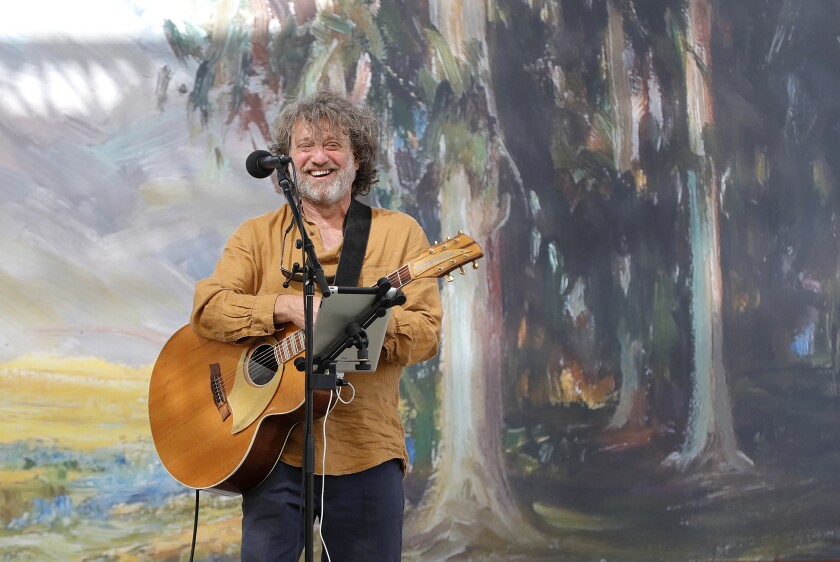 Jason Feddy performs on the main stage on opening day of the Festival of Arts Fine Art Show in Laguna Beach.