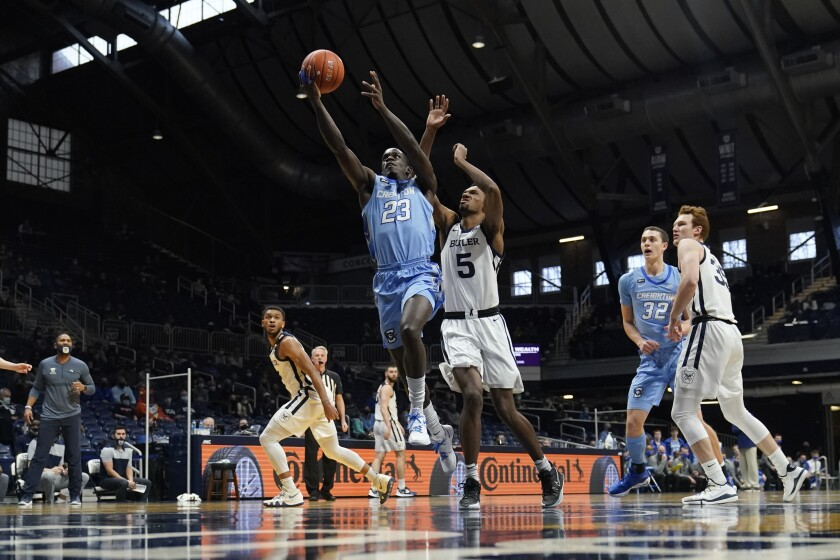 Creighton's Damien Jefferson (23) puts up a shot past Butler's Myles Wilmoth (5) during the first half of an NCAA college basketball game, Saturday, Jan. 16, 2021, in Indianapolis. (AP Photo/Darron Cummings)