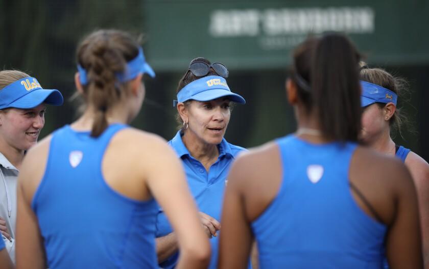 Stella Sampras Webster speaks to her UCLA tennis players.