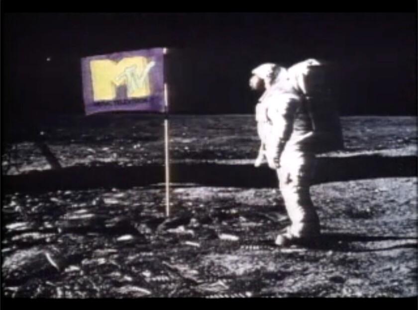Original MTV image of astronaut plating an MTV flag on the moon.