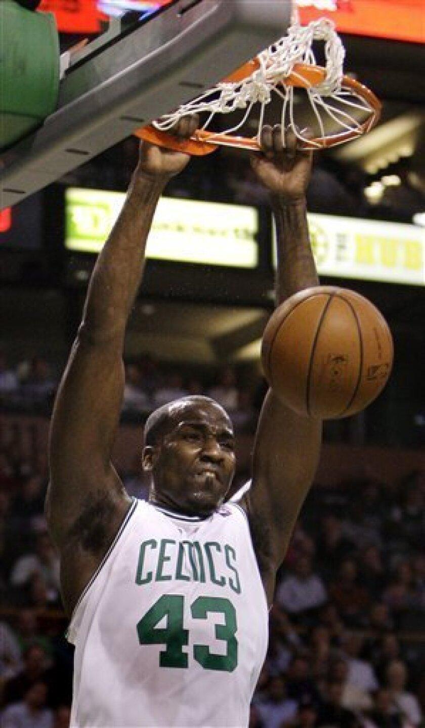 Boston Celtics center Kendrick Perkins (43) dunks against the Orlando Magic in the first half of their NBA basketball game in Boston, Monday Dec. 1, 2008.(AP Photo/Charles Krupa)