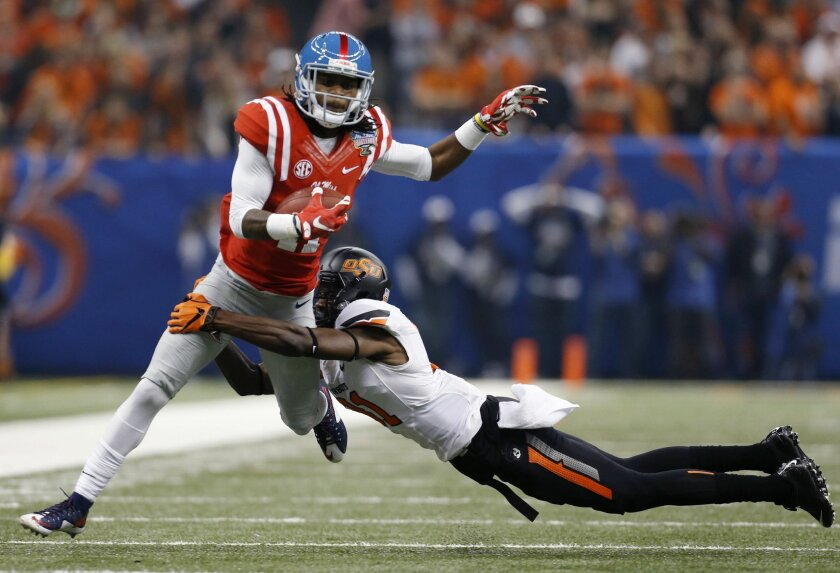 Mississippi wide receiver Markell Pack (11) carries as Oklahoma State safety Tre Flowers tries to tackle in the first half of the Sugar Bowl college football game in New Orleans, Friday, Jan. 1, 2016. (AP Photo/Jonathan Bachman)