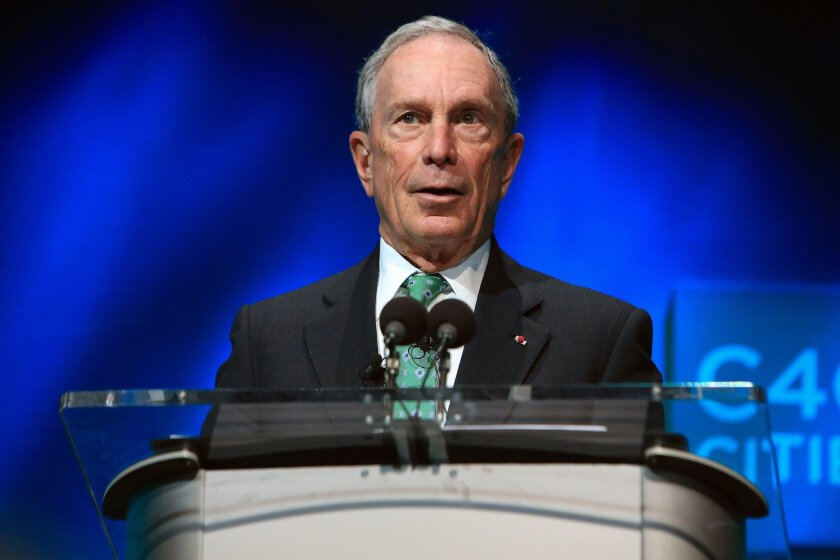 FILE - In this Dec. 3, 2015, file photo, former New York Mayor Michael Bloomberg speaks during the C40 cities awards ceremony, in Paris. For many, Bloomberg's name is synonymous with a pair of political crusades: an anti-gun campaign and a failed takedown of Big Soda. But positions that his support