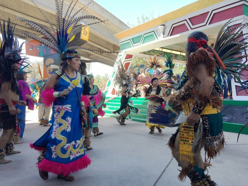 Dancers with the Danza Azteca Calpulli Mexihca company perform Aztec indigenous dances Saturday at the 46th annual Chicano Park Day celebration at Chicano Park in Barrio Logan.