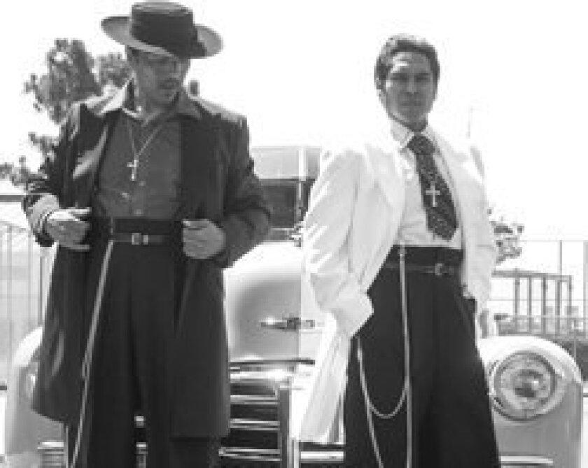 Raul Cardona as El Pachuco and Lakin Valdez as Henry Reyna in San Diego Rep's 'Zoot Suit.' Daren Scott