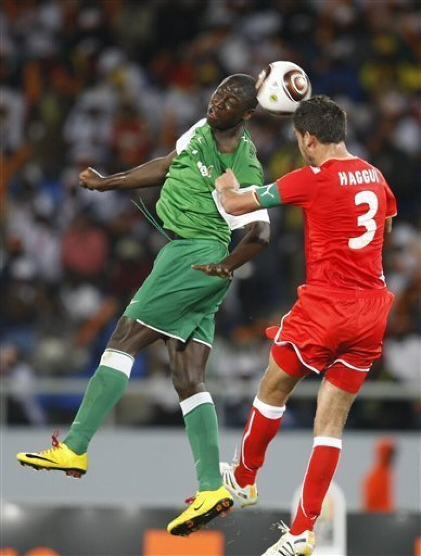 Zambia's Jacob Mulenga, left, and Tunisia's Karim Haggui, challenge for the ball during their African Cup of Nations Group D soccer match at Tundavala Stadium in Lubango, Angola Wednesday, Jan. 13, 2010. (AP Photo/Rebecca Blackwell)