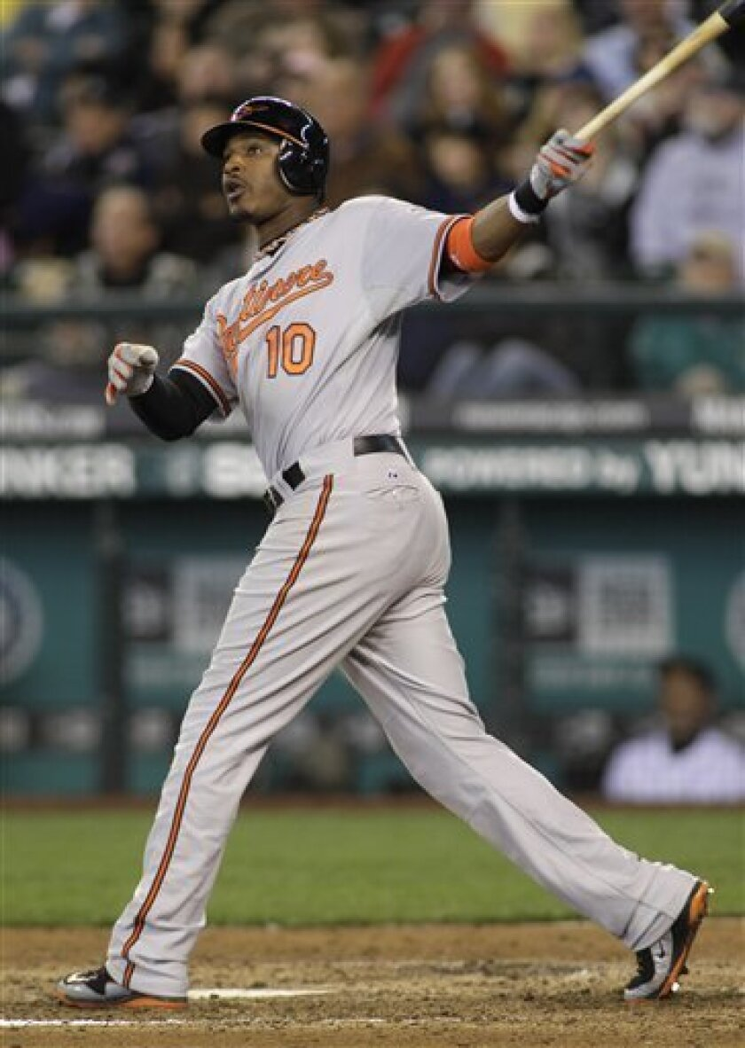 Baltimore Orioles' Adam Jones hits a solo home run against the Seattle Mariners in the eighth inning of a baseball game, Wednesday, June 1, 2011, in Seattle. (AP Photo/Ted S. Warren)