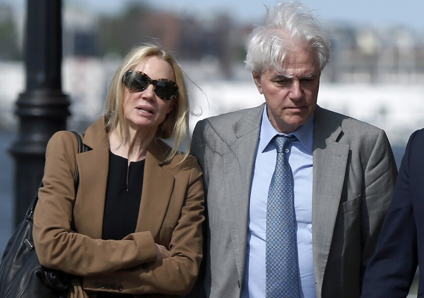 Marcia and Gregory Abbott leave federal court in May. The Abbotts are the sixth and seventh parents to be sentenced in the college admissions scandal.
