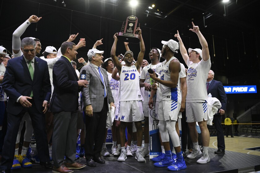 Hofstra players celebrate their Colonial Athletic Assn. championship win Tuesday.