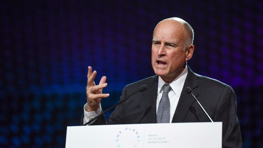 Gov. Jerry Brown speaks about climate change at a summit near Paris on Dec. 12.