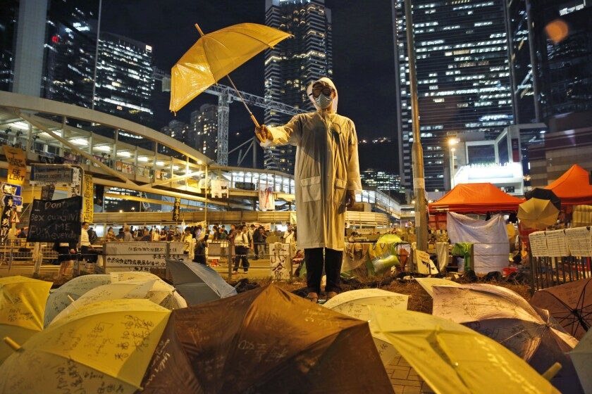 A protester holds an umbrella during a 2014 rally near Hong Kong's government buildings.