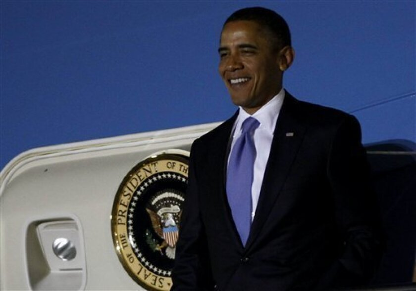 President Barack Obama arrives to attend the G-20 Summit in Seoul, South Korea, Wednesday, Nov. 10, 2010. (AP Photo/Charles Dharapak)