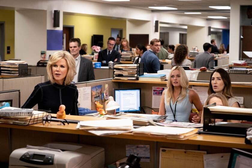"Nicole Kidman, left, Margot Robbie and D'Arcy Carden in ""Bombshell."""