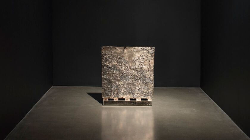 """Gates' father was a roofer — and this bronzed roofing tile, titled """"Tar Section,"""" is a nod to that history."""