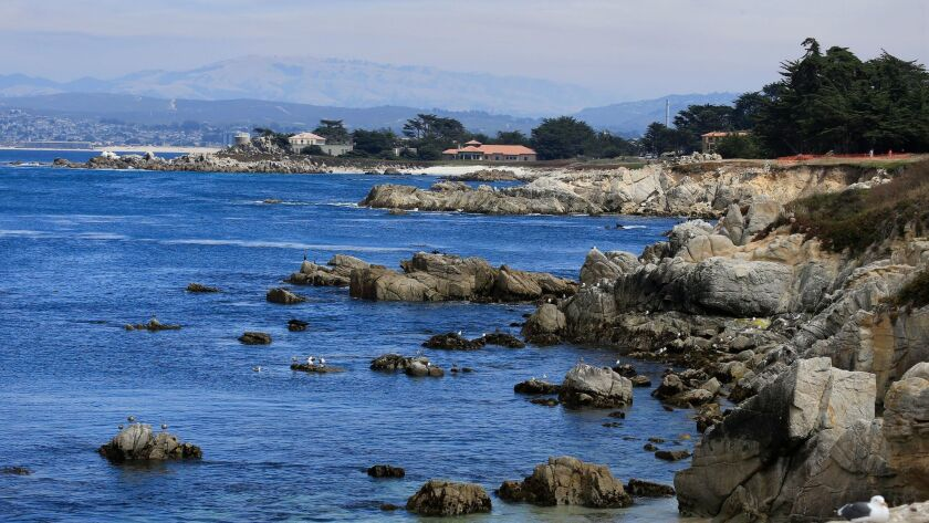 MONTEREY, CA -- TUESDAY, AUGUST 2, 2016: A scenic view of the rocky Monterey Bay shoreline on a sum