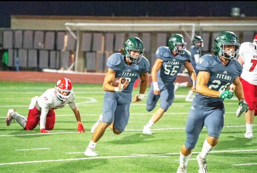 Poway High's Conner Rath running with the ball during a game.