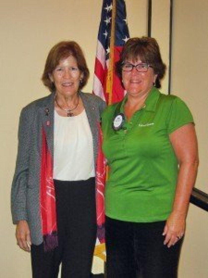 Left, Louise Andres, District Governor for Rotary Clubs in San Diego and Imperial Valley counties, with Diane Huckabee, new president of the Del Mar-Solana Beach Rotary Club.