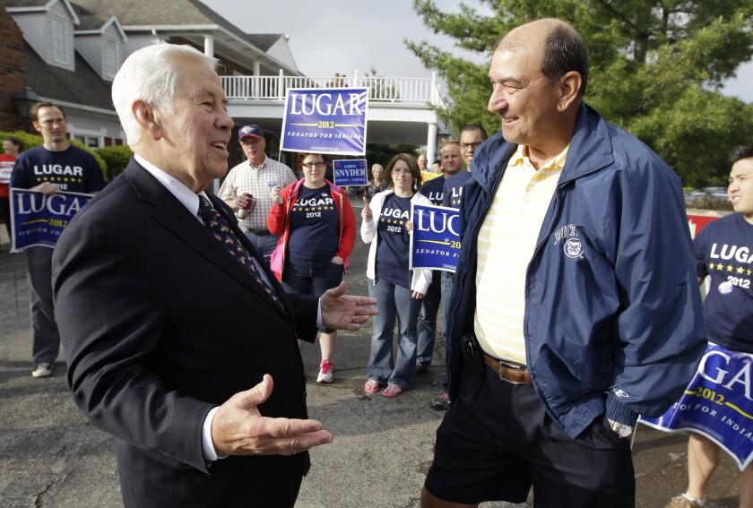 Sen. Richard G. Lugar talks with Joe Purichia before voting in Greenwood, Ind.