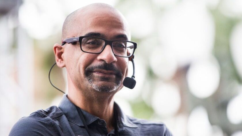 """Author Junot Díaz reads his book, """"Islandborn,"""" at the Reading by 9 Children's stage during the annual Los Angeles Times Festival of Books on April 21, 2018."""