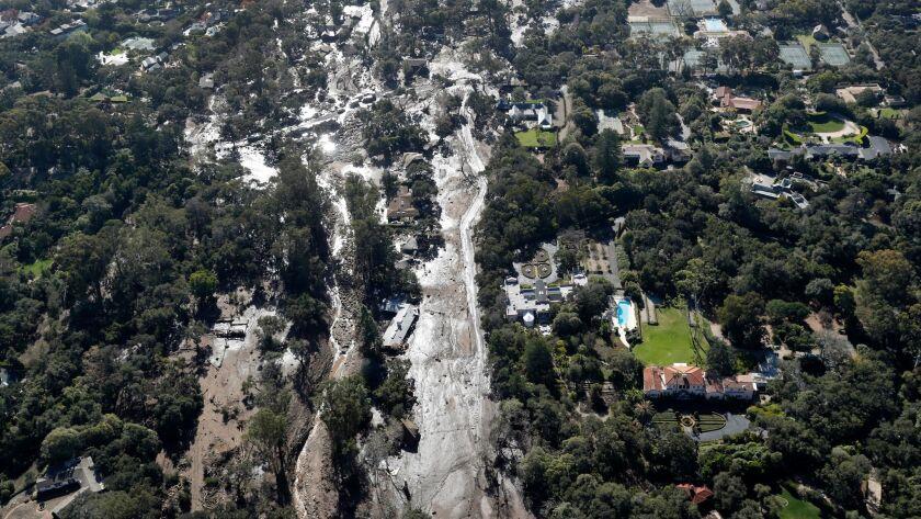 Mud and debris surround homes in Montecito on Jan. 10, 2018.
