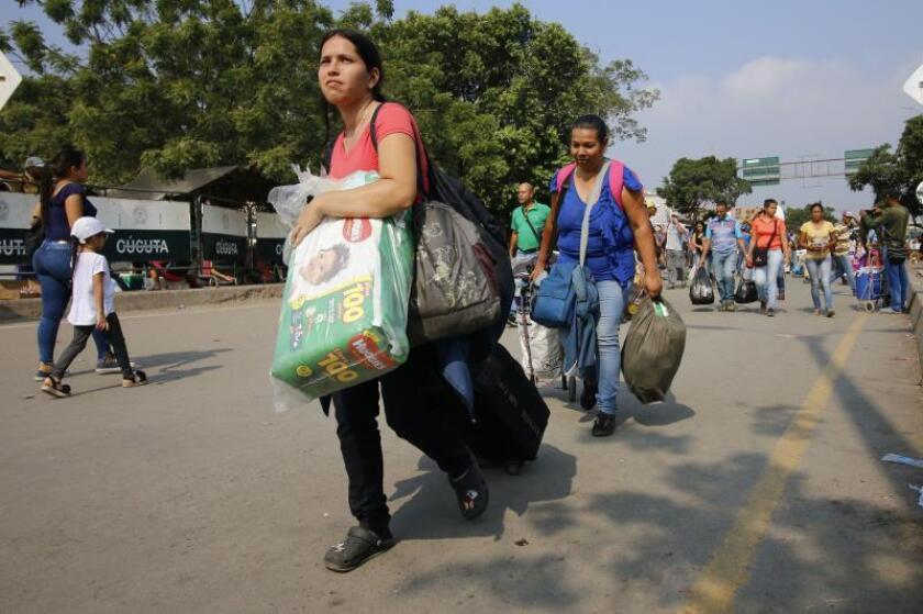 Some 35,000 Venezuelans cross daily into Colombia to buy the minimum amount of food and medicines they need to survive, as seen in this photo of Feb. 5, 2019 - they now anxiously await the distribution of humanitarian aid from abroad, though President Nicolas Maduro has forbidden its entry into Venezuela. EFE-EPA/Schneyder Mendoza
