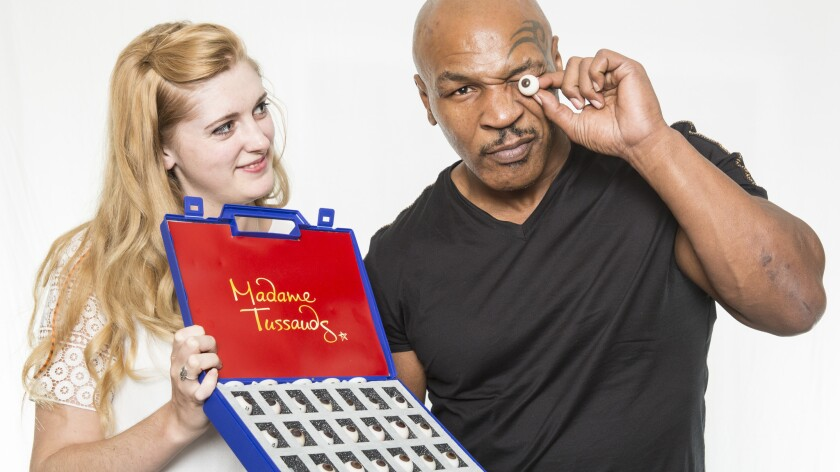 Mike Tyson poses with a synthetic eye during his meeting with a member of Madame Tussauds' creative team during a design session in the spring.