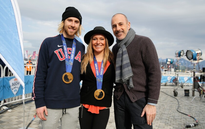 "Sage Kotsenburg and Jamie Anderson of the USA Snowboarding team pose with their gold medals and Matt Lauer of NBC's ""TODAY Show,"" who will be taking over for Bob Costas."