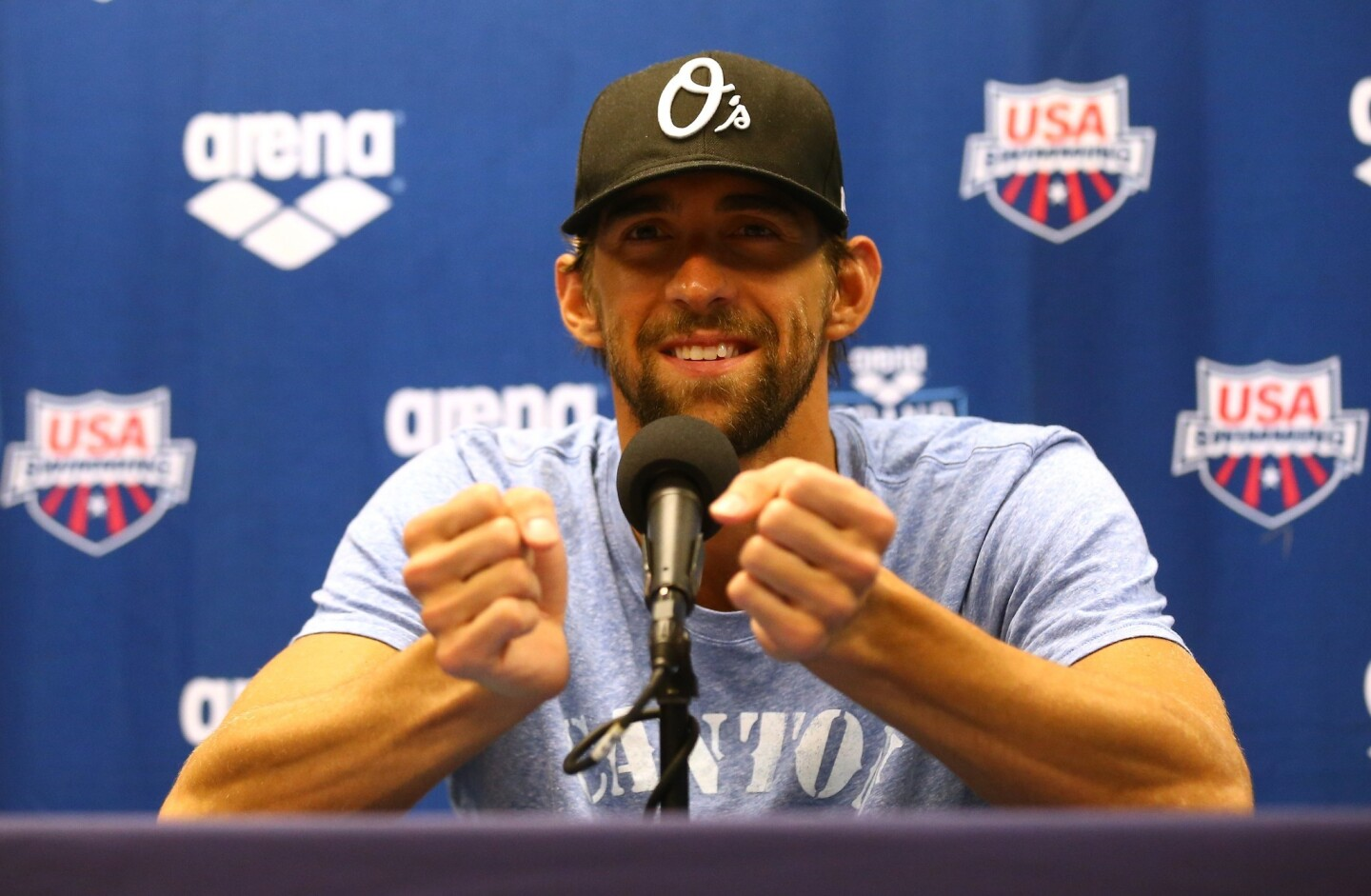 Michael Phelps speaks to the media after his training session ahead of the Arena Grand Prix at Charlotte.