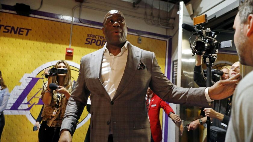 Magic Johnson speaks to media members at Staples Center.