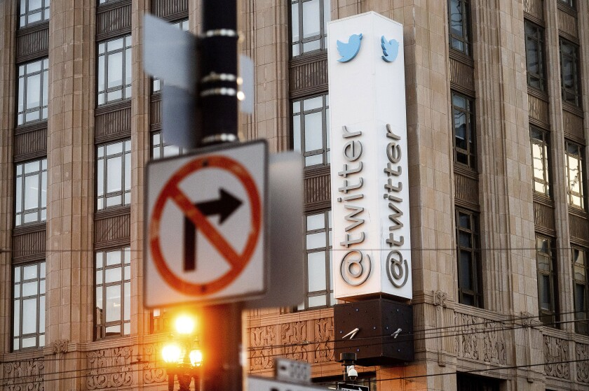 FILE - In this Jan. 11, 2021, file photo, a sign hangs at Twitter headquarters in San Francisco. Republican state lawmakers are pushing for social media giants to face costly lawsuits for policing content on their websites, taking aim at a federal law that prevents internet companies, like Twitter, from being sued for removing posts. (AP Photo/Noah Berger, File)