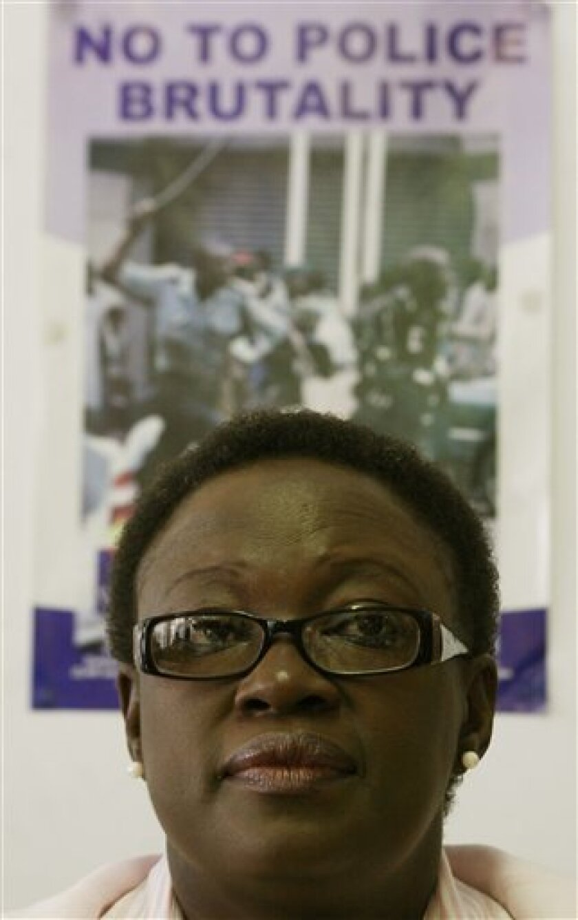 Zimbabwe human rights activist Jestina Mukoko at a news conference in Harare, Thursday Oct. 1, 2009. The lawyer for a prominent Zimbabwean human rights activist Jestina Mukoko and eight others says they are suing the government for US$500 million after their terror charges were dropped. Harrison Nkomo said Thursday that he is suing several officials for the abduction, wrongful arrest and torture of Jestina Mukoko and the others. The case targets the national police commissioner, intelligence minister and several police officers. (AP Photo)