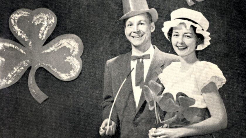 """Bob and Betty McMurray are featured in a March 1958 publicity photo for the La Cañada Flintridge Women's Club's """"Erin Go Bragh"""" dinner dance in celebration of St. Patrick's Day. The event was held at Altadena Town & Country Club."""