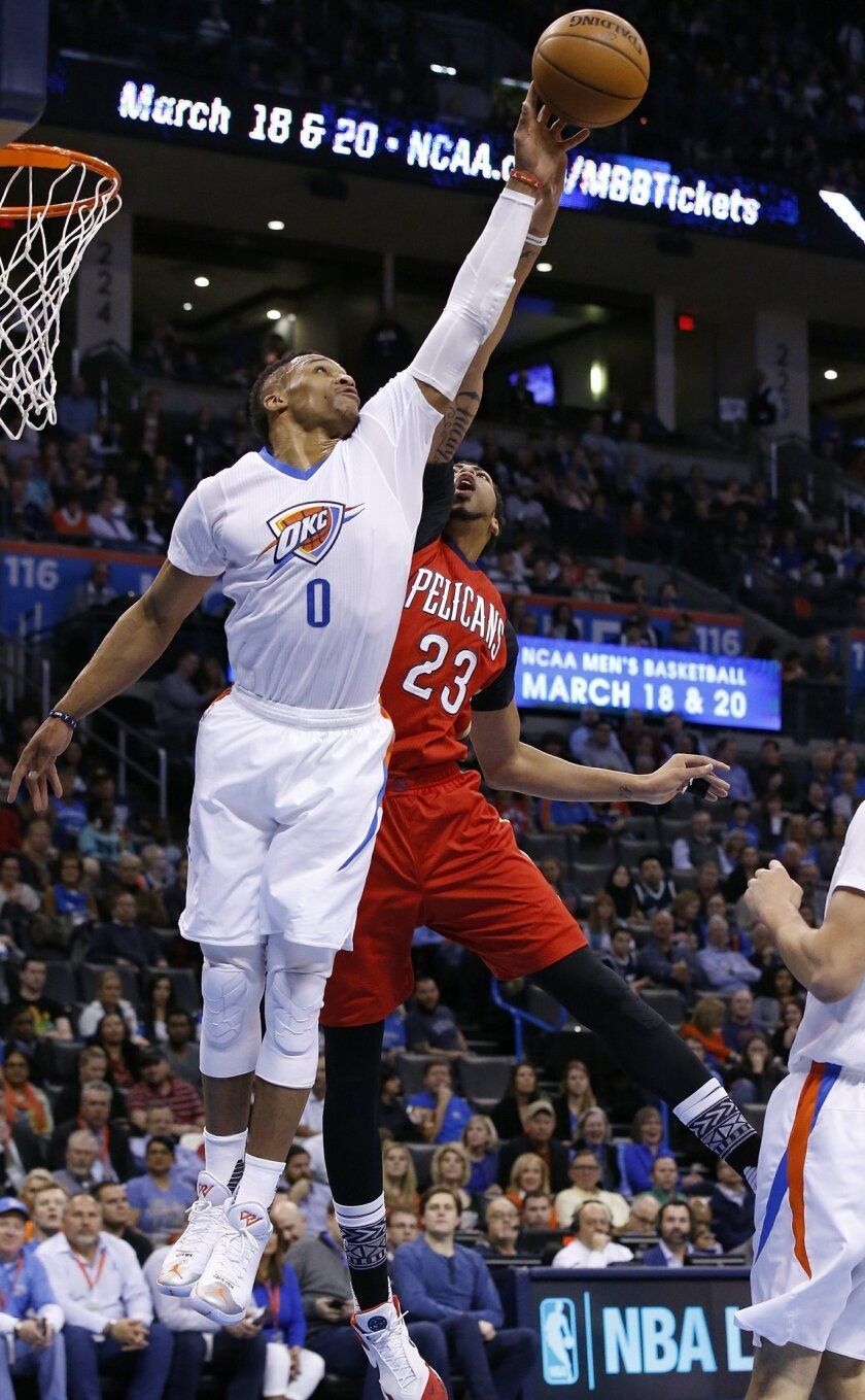 Oklahoma City Thunder guard Russell Westbrook (0) blocks a pass intended for New Orleans Pelicans forward Anthony Davis (23) in the first quarter of an NBA basketball game in Oklahoma City, Thursday, Feb. 11, 2016. (AP Photo/Sue Ogrocki)