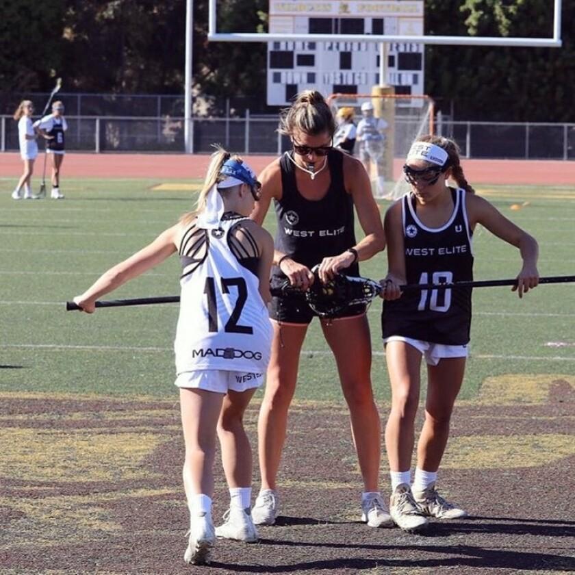 Kelsey Cuje on a field coaching.