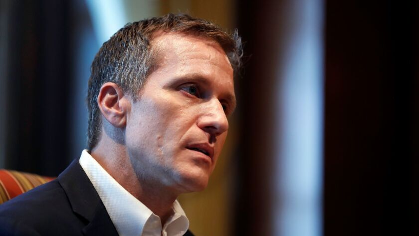 Missouri Gov. Eric Greitens listens to a question during an interview in his office at the Missouri Capitol on Saturday, Jan. 20, 2018, in Jefferson City, Mo. Greitens discussed having an extramarital affair in 2015 before taking office.