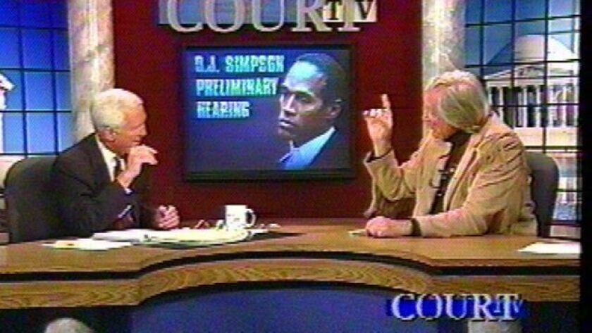 Anchor Fred Graham and defense lawyer Gerry Spence discuss the O.J. Simpson trial on the original Court TV.