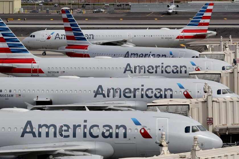 American Airlines jets sit at their gates at Sky Harbor International Airport in Phoenix.