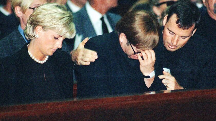 Gianni Versace's star power thrust his killer Andrew Cunanan into the celebrity spotlight. At Versace's memorial mass in Milan, Princess Diana sat beside British pop star Elton John, (being comforted an unidentified man). Within weeks, the world would be mourning Princess Diana.