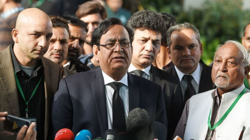 Saiful Malook, center, the lawyer for Asia Bibi, speaks to the media outside the Supreme Court building in Islamabad, Pakistan, on Jan. 29.