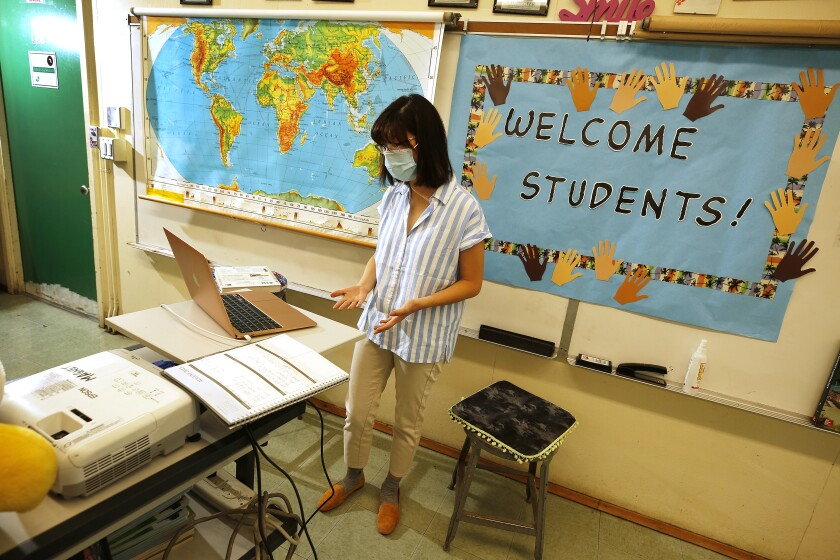 Eagle Rock Junior/Senior High School history teacher Alice Lee interacts virtually with her students on Aug. 21.