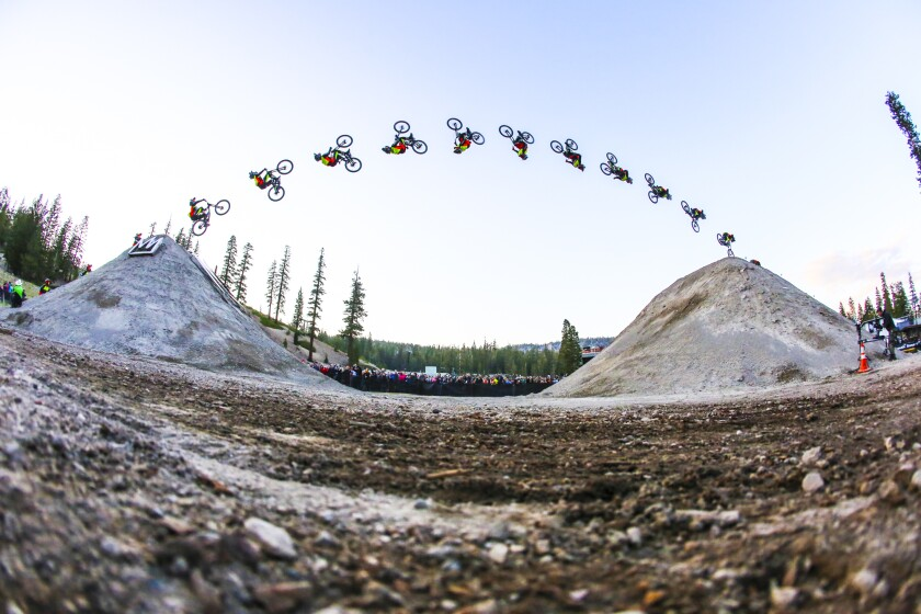 Cam Zink sets a Guinness World Record for the longest mountain bike dirt-to-dirt backflip in 2016 at Mammoth Bike Park.