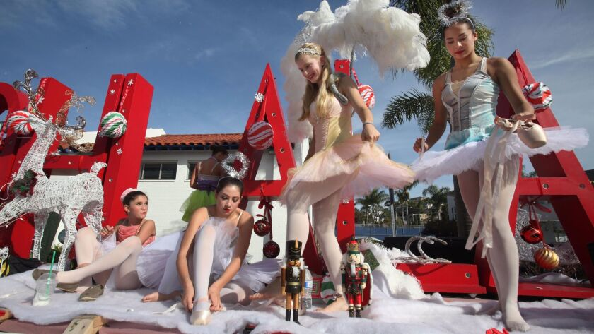 December 7 , 2014 San Diego, CA. USA | Ballerinas from the Ooh La La Dance Academy climb aboar