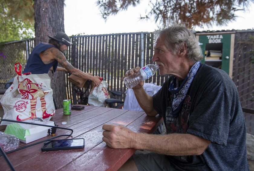 Patrick Hogan has a glass of water at Mary's Kitchen in Orange on Tuesday July 13.
