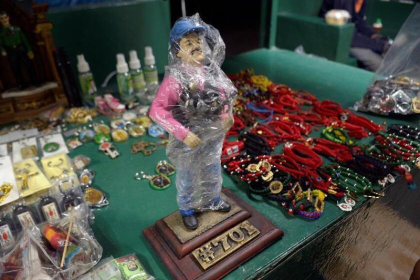 "A view of a Joaquin ""El Chapo"" Guzman-themed action figure for sale at a store in Culiacan, Sinaloa state, Mexico, on Feb. 19, 2019. EPA-EFE/Juan Carlos Cruz"