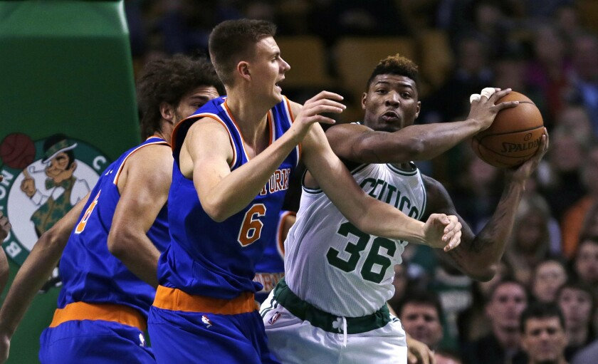 New York Knicks forward Kristaps Porzingis pressures Boston Celtics guard Marcus Smart during the first quarter of a game on Oct. 22.