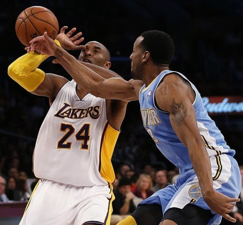 Nuggets' Andre Iguodala knocks the ball away from Lakers guard Kobe Bryant in the first half of a game last month.